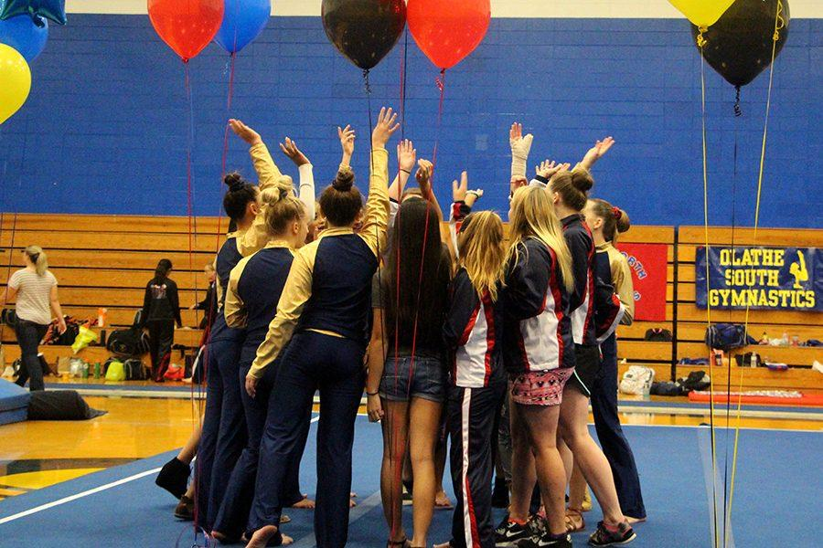 Members of the gymnasts squad celebrate at the end of a meet.