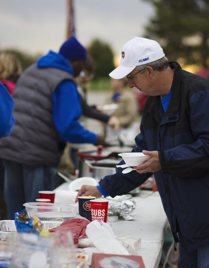A Booster Club member eats chili. The Football Booster Club hosts a tailgate before every home varsity football game.