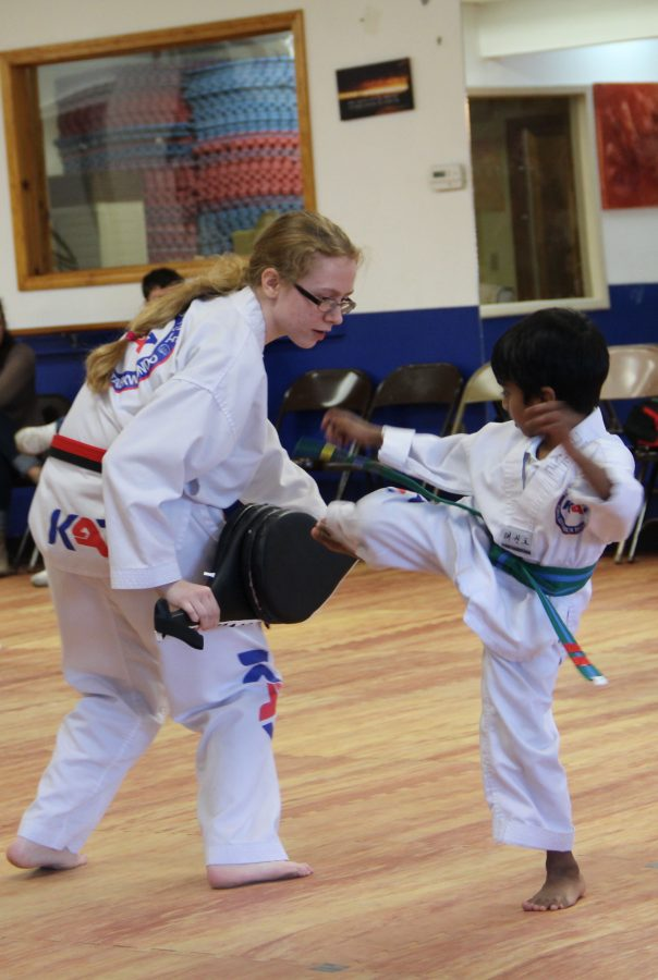 South student, Celina Willians, senior, receives kicks from one of her pupils during a belt test.