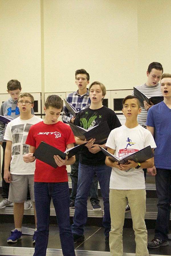 Mens choir practicing for Holiday Magic.
