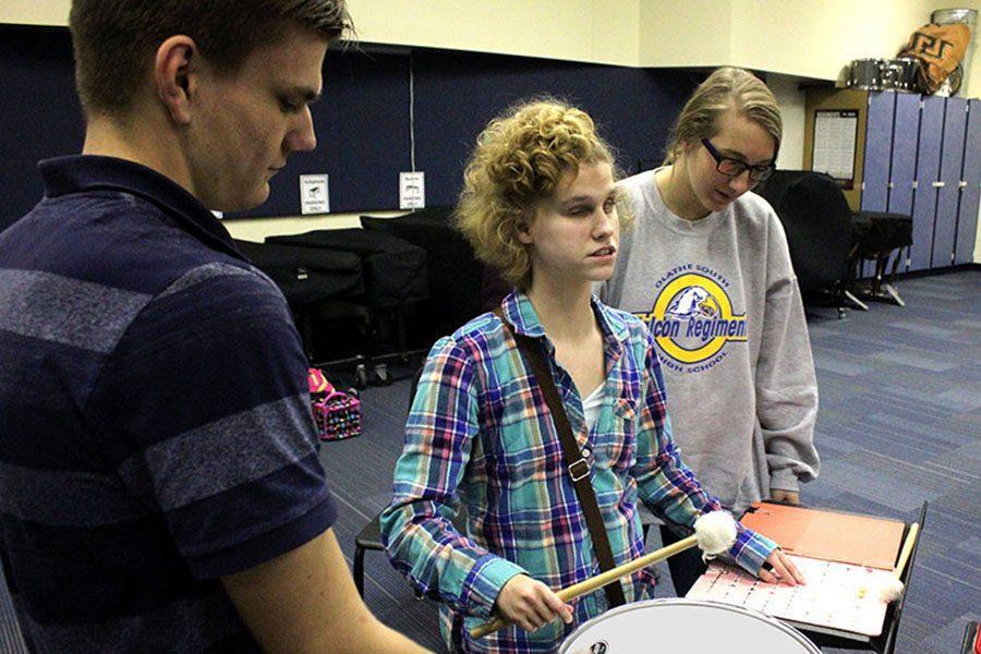 Band students Zack Hodgson, Senior, and Mikayla Boyd, Sophomore, teach drumming for Breana Macdonald, Senior.