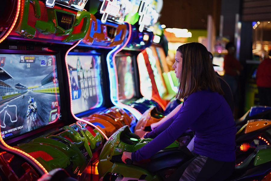 Sarah Buehler plays a motorcycle game.