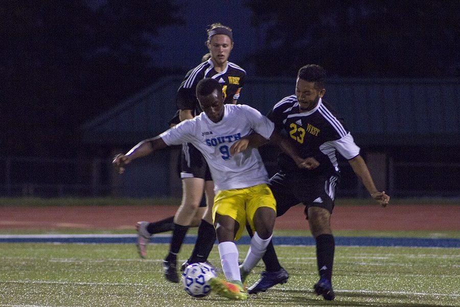 Emmanuel Okwuone, junior, fights over the ball.