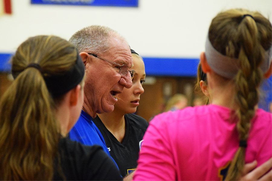 Ken Talcott, coach,  encouraging the volleyball varsity team members during the game on Oct. 11