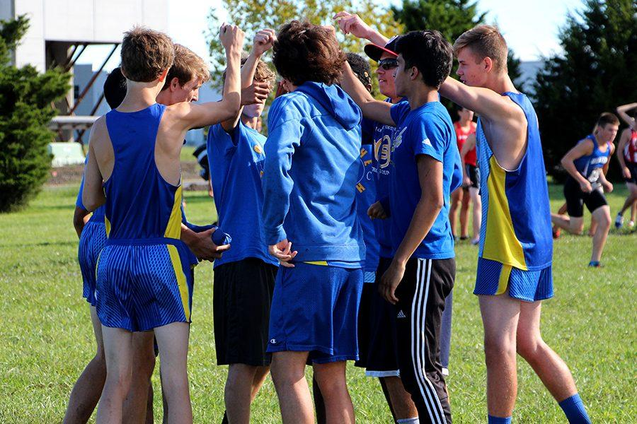 Boys on the varsity team get ready to run.