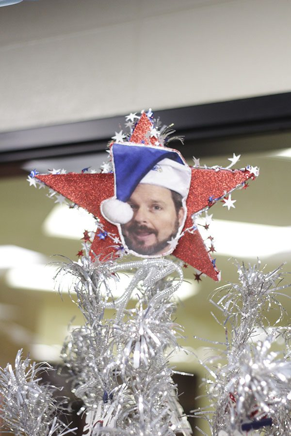 The library is festively decorated for the holidays. Kevin Spritzer is featured on the star of the Social Studies tree.