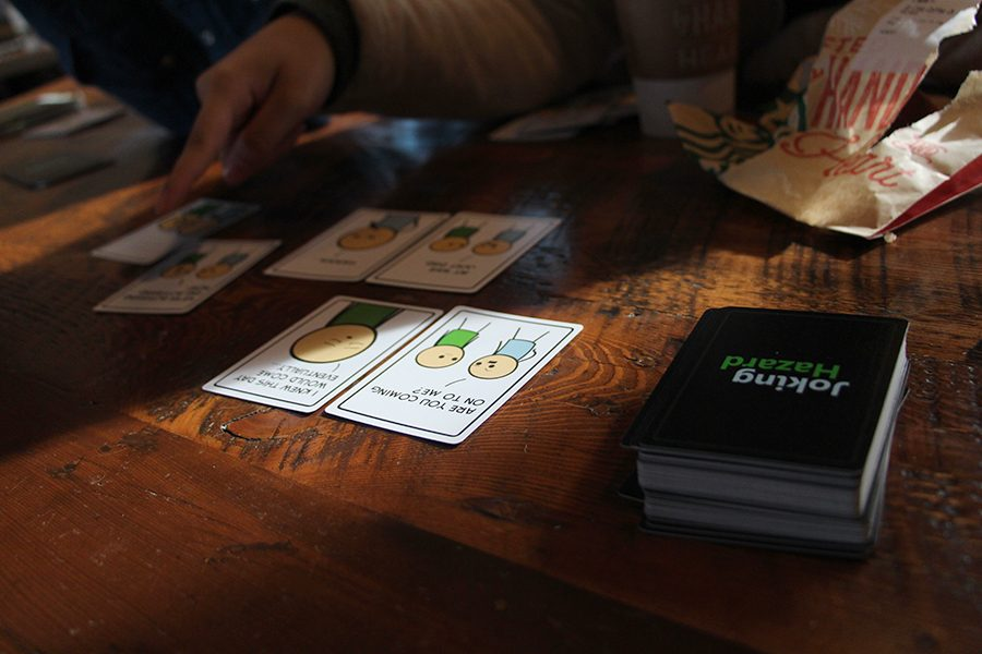 Megan Pham, Aysiah Loving, Evan Kauffman, juniors, and Peyton Mosher and Christian Cortes, seniors, gathered at Starbucks during winter break to play Joking Hazard.  The students got to enjoy coffee while playing the card game.