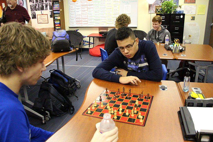 Byron Rodriguez, Sophomore, and Connor Horn, Senior, Playing a game of chess.