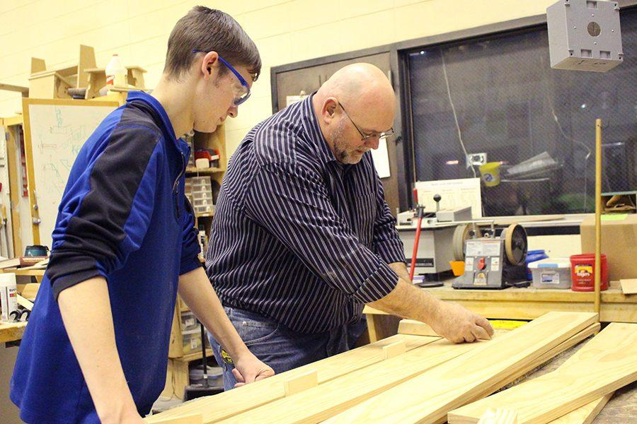 Mr. Wheeler works with his students in his woodshop class to create beautiful projects. Heis getting new equipment soon from a grant he applied for.