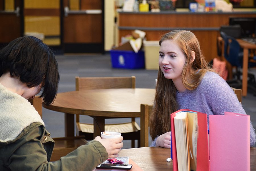 Amanda Pendley, senior, arriving at a table set up for the blind date with a book event in the library Feb. 2.