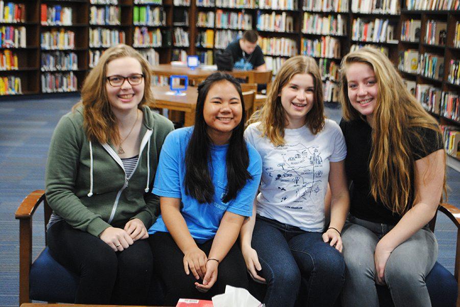 Miriam Gaentgen, Hemsuda Hemapusit, Maddalena Pilan, and Ophelie Bakker smiling in the library April 5th.