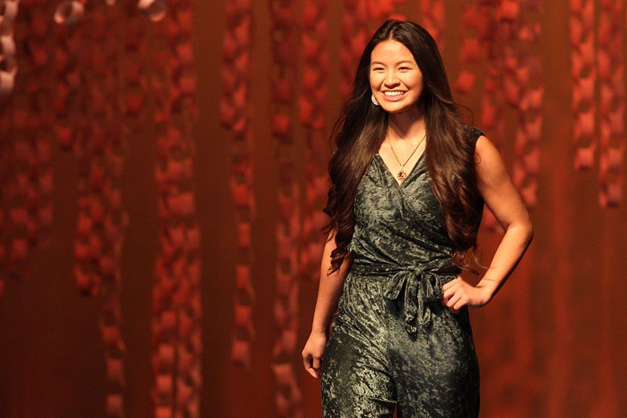 Courtney Saysiri, senior, walks in the fashion show.