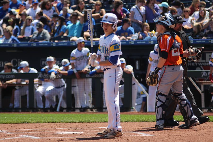 Jake Riley, goes up to bat at the baseball game against Olathe East at Kauffman Stadium.