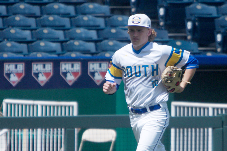Jake Riley, senior, running back into the dugout. The varsity baseball team played Olathe East at Kauffman Stadium on 4/24.