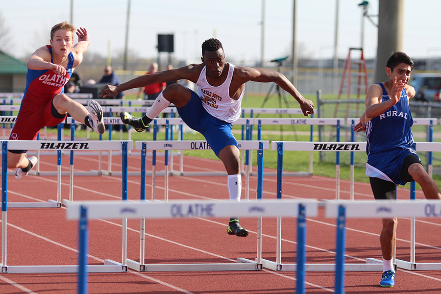 Emmanuel+Okwuone%2C+junior%2C+leaps+over+a+hurdle+during+a+race.