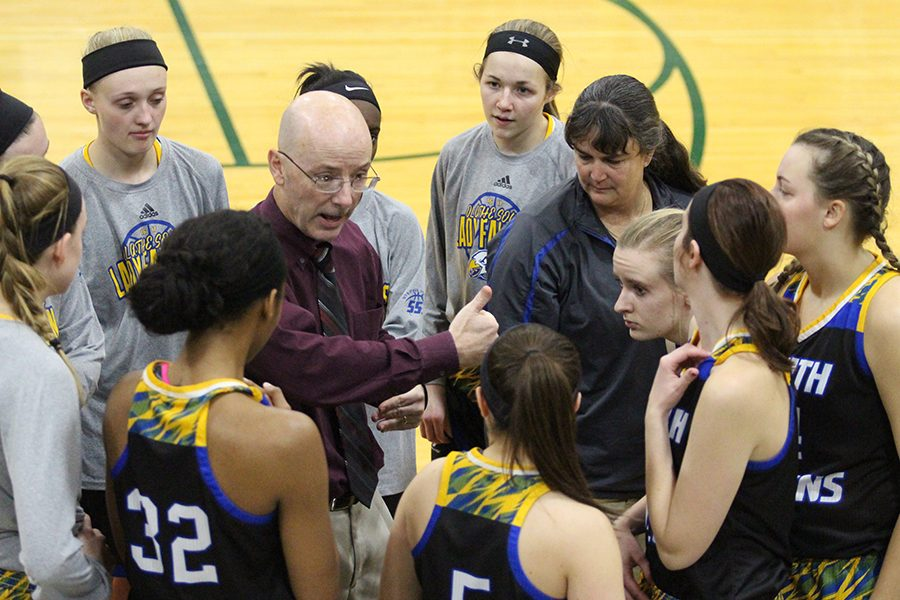 Girls Basketball huddle Shawnee Mission South away game