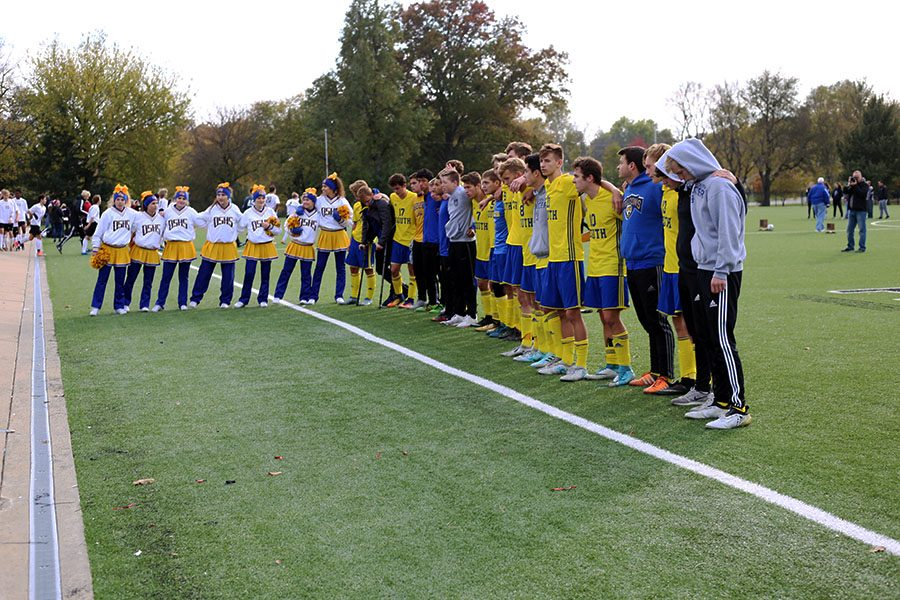 The boys soccer team lines up to sing the alma mater after the state soccer game against Blue Valley West. The team got second place  in the 6A state championship.