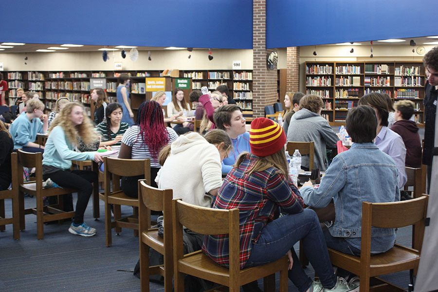 Students socialize at the Anti-Valentine's event in the library on Feb. 15.