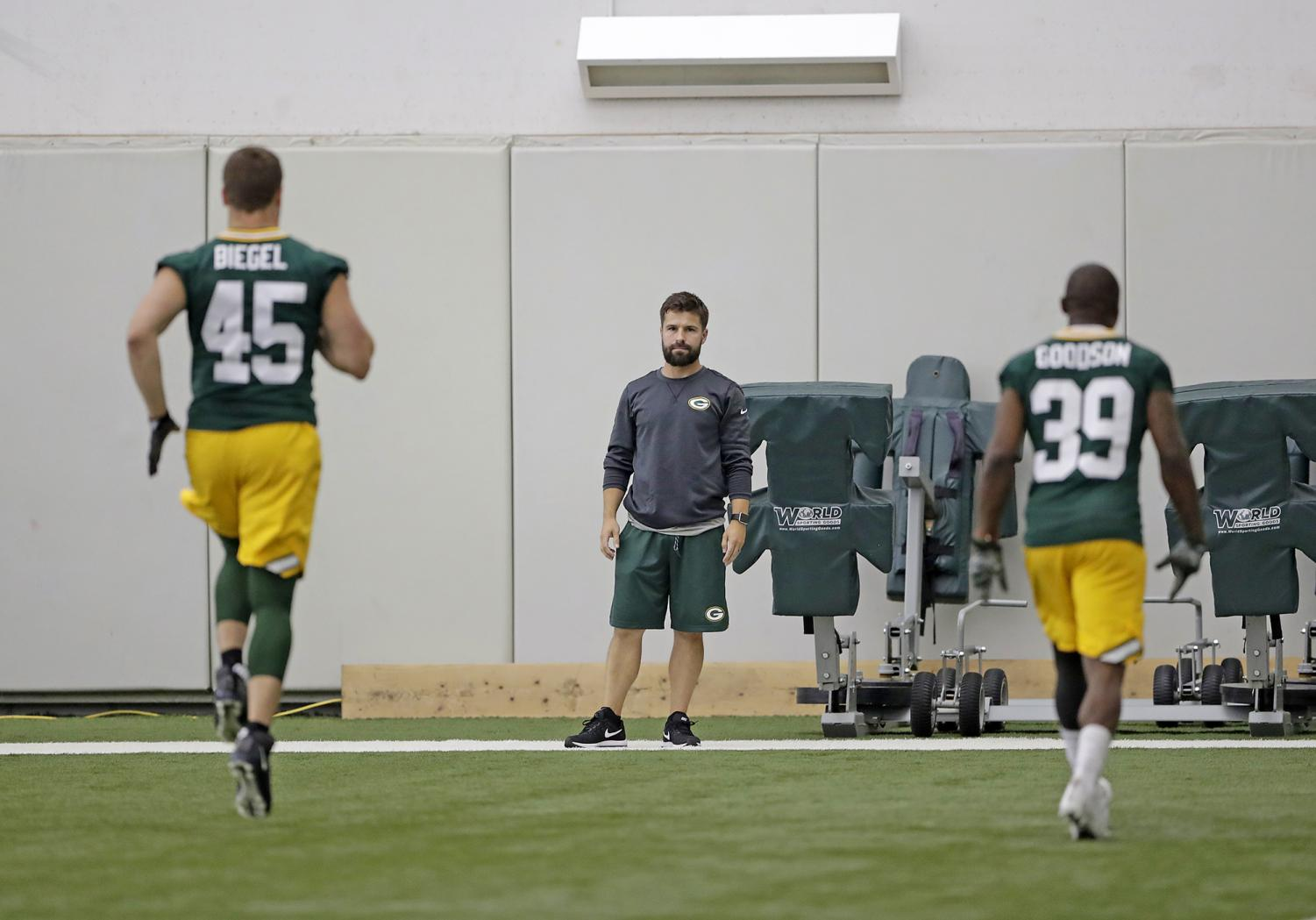 Nate Weir, athletic trainer, is shown above supervising the conditioning of Green Bay Packers players,  Vince Biegel and Demetri Goodson. Weir has worked with the Packers as an athletic trainer for a combined total of 17 years.