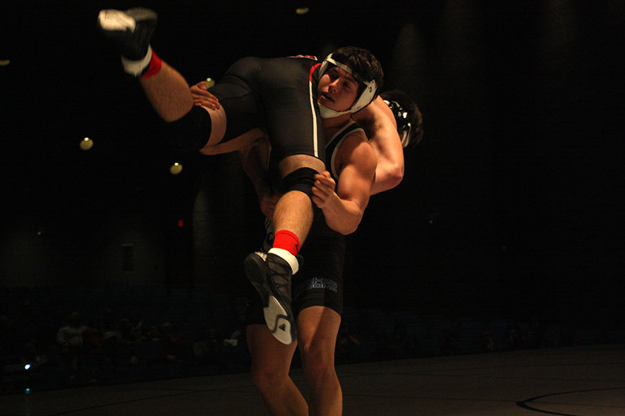 Nick Jouret,senior,  competes at a wrestling meet and is in the weight class 182. He has been wrestling for 13 years and recently broke the all-time win record with 146 wins. He is planning on wrestling in college but is unsure where he will attend.