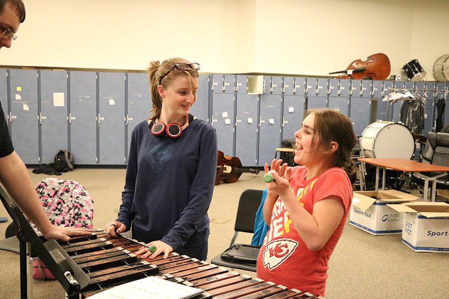 Part+of+United+Sound+is+sharing+the+fun+of+music+as+seen+with+these+two+who+are+working+on+the+xylophone.