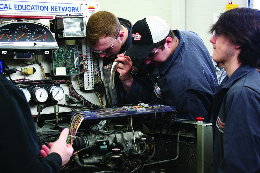 Students in Auto Technology are testing a mock up of a car engine.