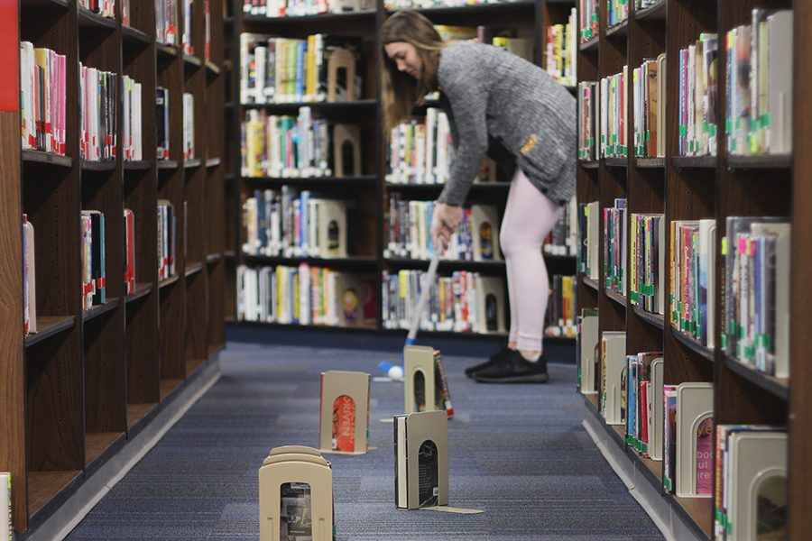 Students+took+a+break+from+books%2C+and+instead+played+miniature+golf+in+library+March+27+after+school.