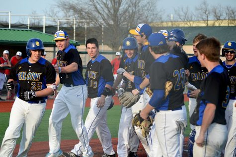 The baseball team returns to the dugout after celebrating a home run against Olathe North. It was announced on March 18 that there would be no fireworks this year, however, as all spring sports have been canceled in their entirety.