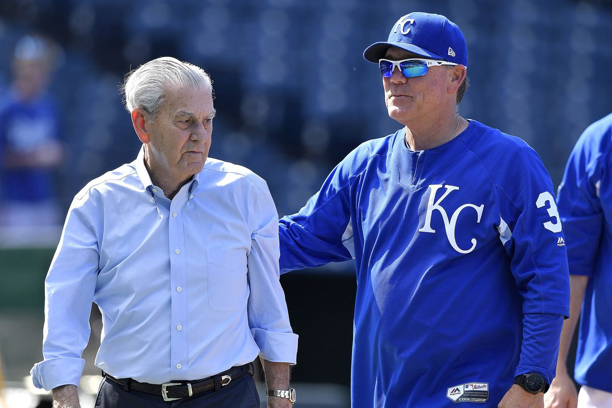 David Glass, Royals owner, and Ned Yost, Royals manager, talk before a game. Glass announced on Aug. 30 that he would sell the team to John Sherman, businessman. Glass has been the sole owner of the team since 2000.