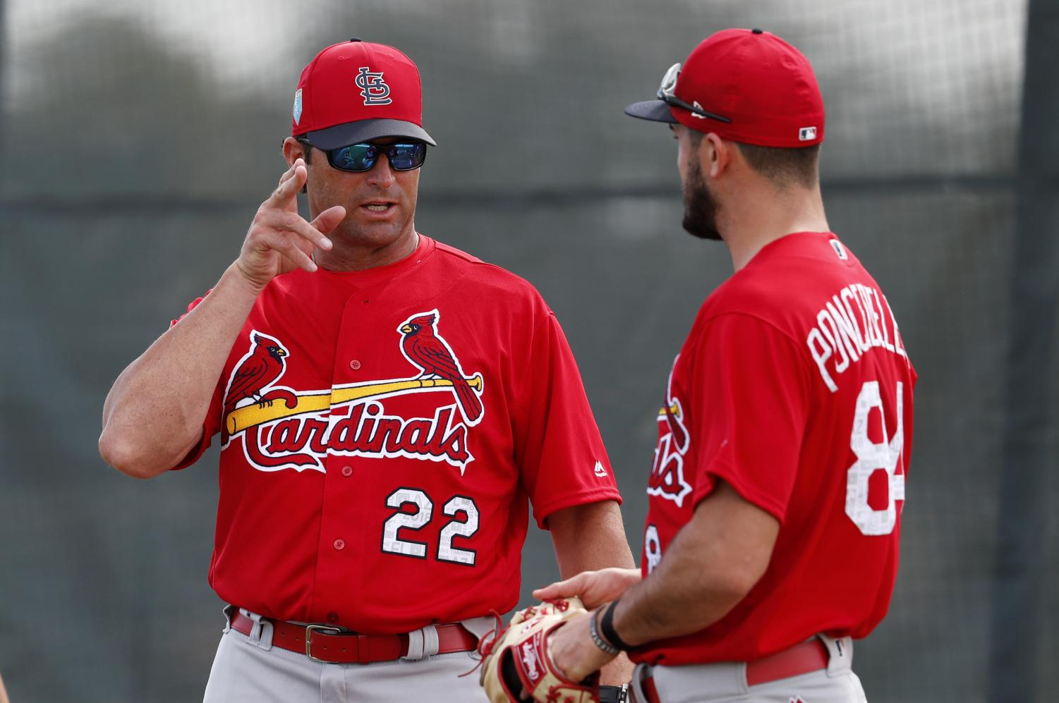 Mike Matheny, Royals manager, talks about pitching with Daniel Ponce de Leon, pitcher, during his time with the St. Louis Cardinals. Matheny was hired as the 20th manager in Royals history.