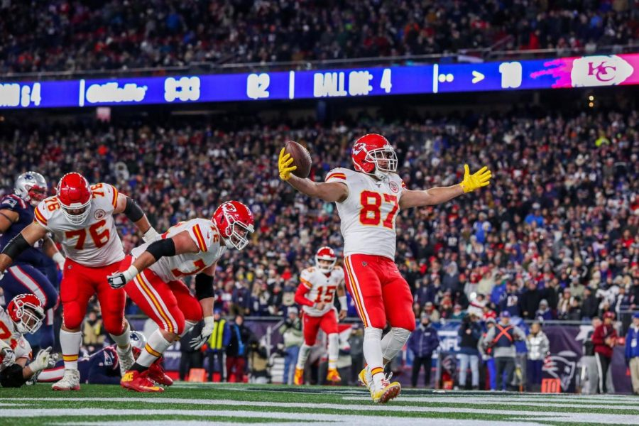 Travis+Kelce%2C+tight+end%2C+celebrates+in+the+end+zone+after+giving+the+Chiefs+a+16-7+lead.+Kelce+directly+took+the+snap%2C+fooling+the+Patriots+into+thinking+it+was+a+potential+trick+play.+In+addition+to+the+touchdown%2C+he+caught+seven+passes+for+66+yards+as+the+Chiefs+beat+the+Patriots+23-16.