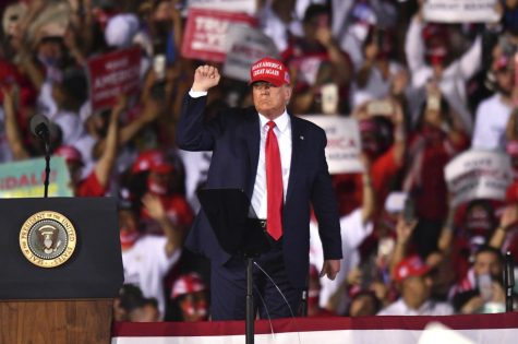 President Donald Trump salutes the crowd following his Nov. 2 rally in Opa-Locka, Florida.