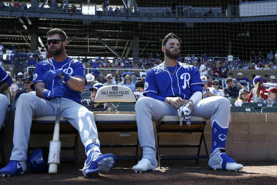 Kansas City Royals outfielders Bubba Starling (left) and Ryan McBroom (right) sit next to each other before the start of a Spring Training game in 2020. Just days later, MLB would suspend its season in the midst of the COVID-19 pandemic.