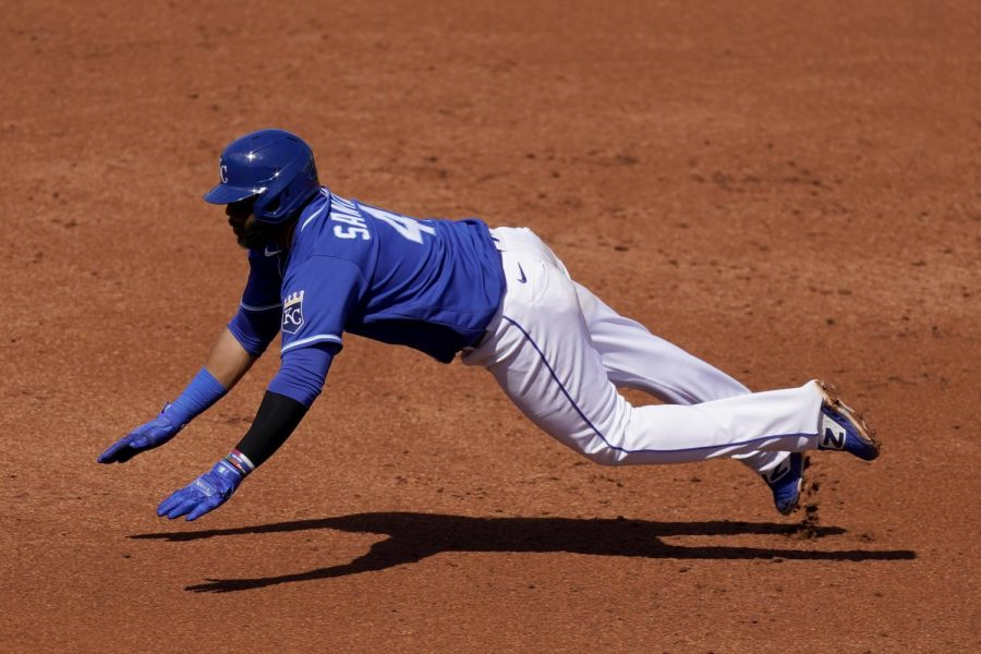 Royals first baseman Carlos Santana dives into third base during a game against the Texas Rangers. Santana was signed in the offseason in effort to boost the Royals' offensive production from the middle of the batting order.