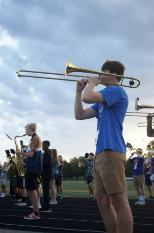 Junior Carter Stokes plays along with the band during one of their block day rehearsals.